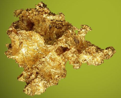 Gebilde aus Gold auf grünem Hintergrund